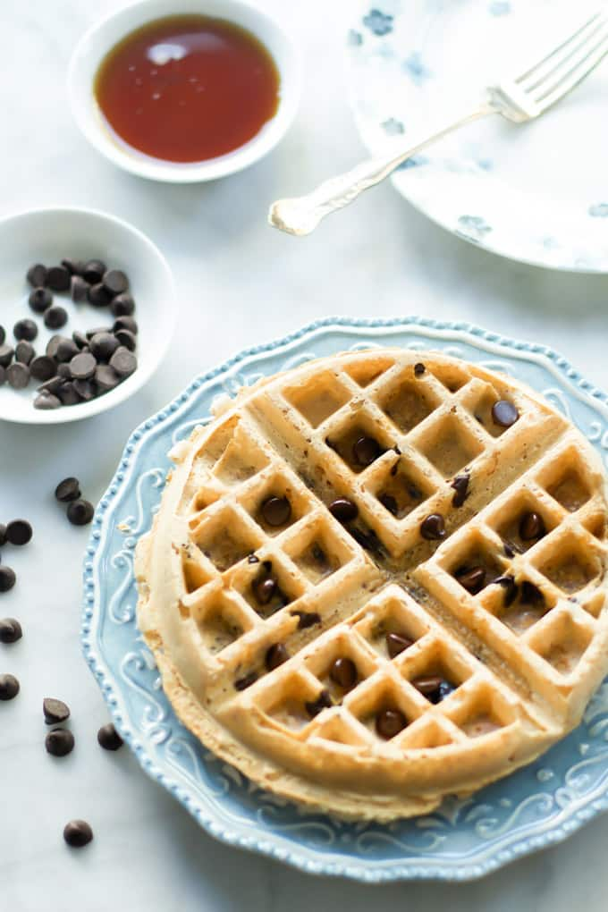 A serving of almond butter waffle on a blue plate.