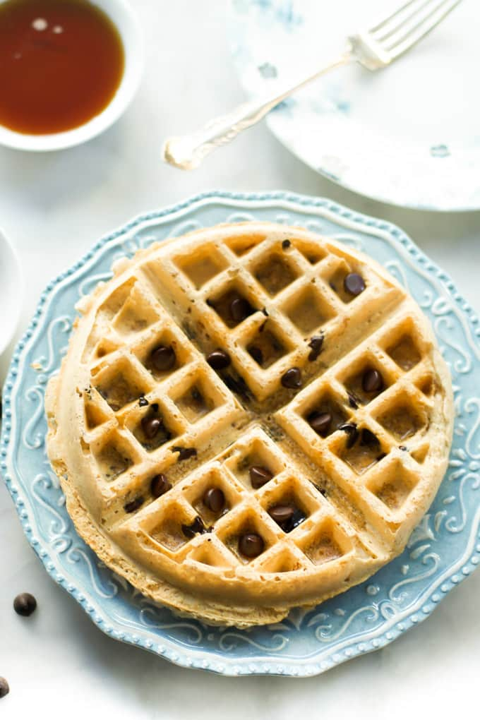 An almond butter waffle on a plate.