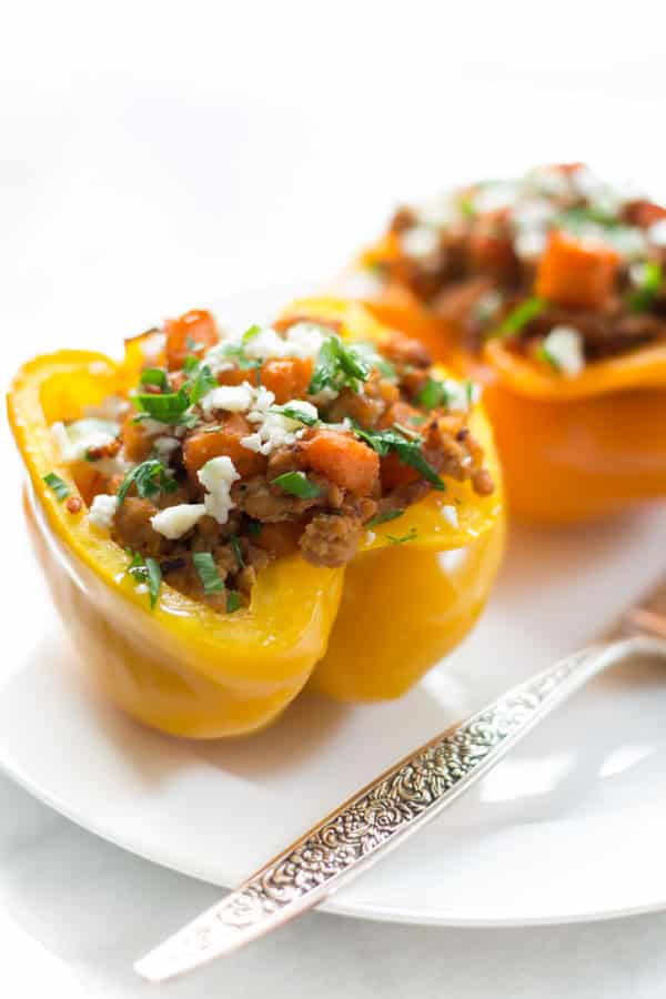 Close up of ground turkey sweet potato stuffed inside of a yellow bell pepper.