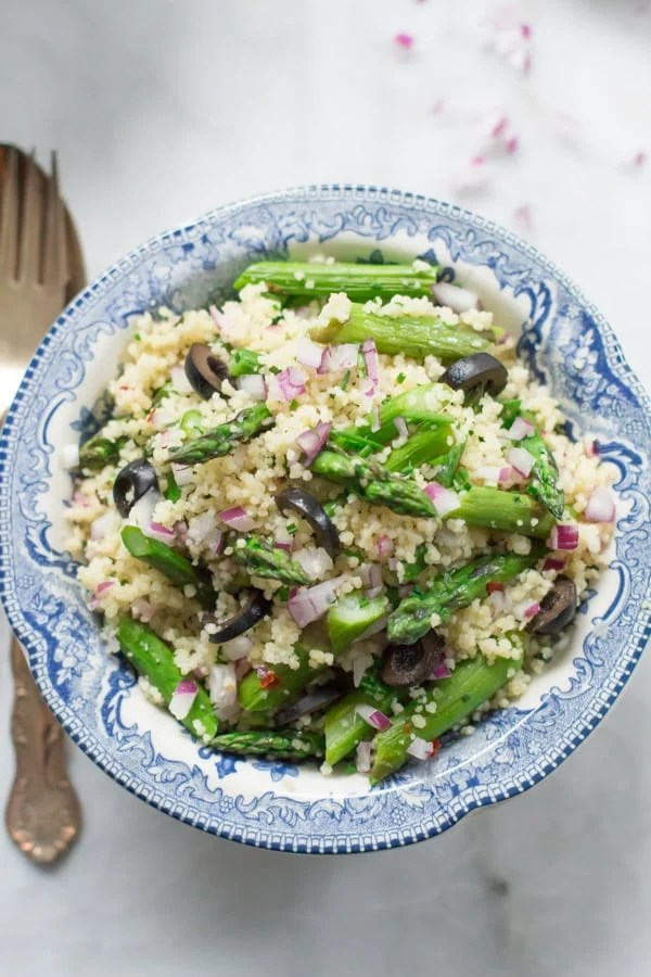 Asparagus Couscous Salad - This fresh, summery and simple asparagus couscous salad is tossed with asparagus, whole wheat couscous, red onions, kalamata olives and homemade vinaigrette. This is definitely a tasty and vibrant summer meal.