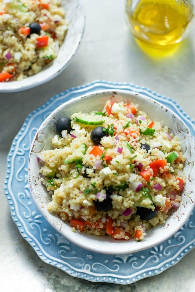 An overhead photo of a bowl of quinoa greek salad.
