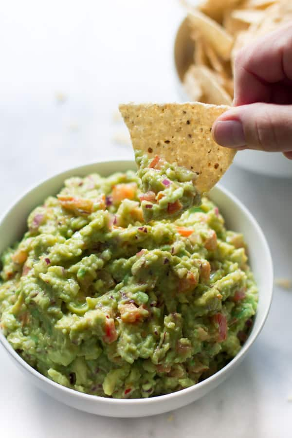 Easiest Guacamole Recipe - This is the easiest guacamole recipe you can find. You will love this simple, quick and incredibly tasty healthy dip. We love it!