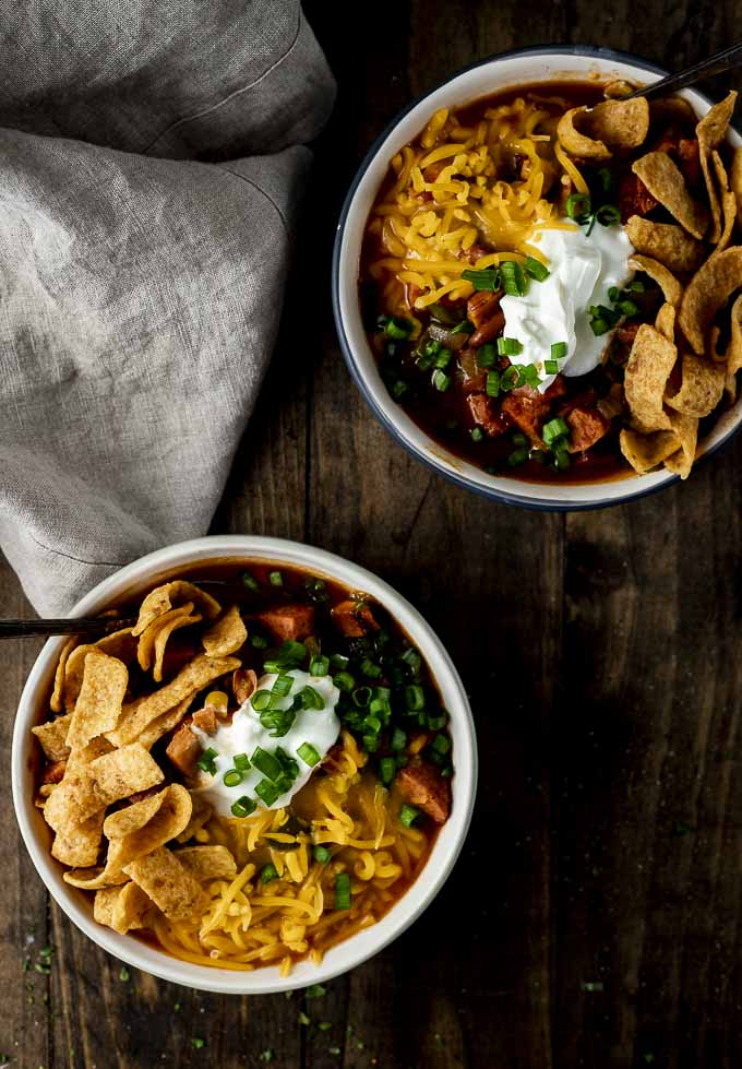 overhead of two white bowls of turkey chili