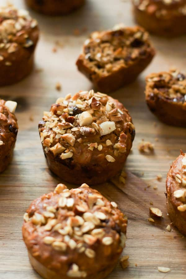 gluten-free-carrot-muffins - These Gluten-free Carrot Muffins are made with rice flour, rolled oats, no butter or oil and loaded with carrots, nuts, Greek yogurt and semi-sweet chocolate chips. They are also delicious with a warm cup of coffee!