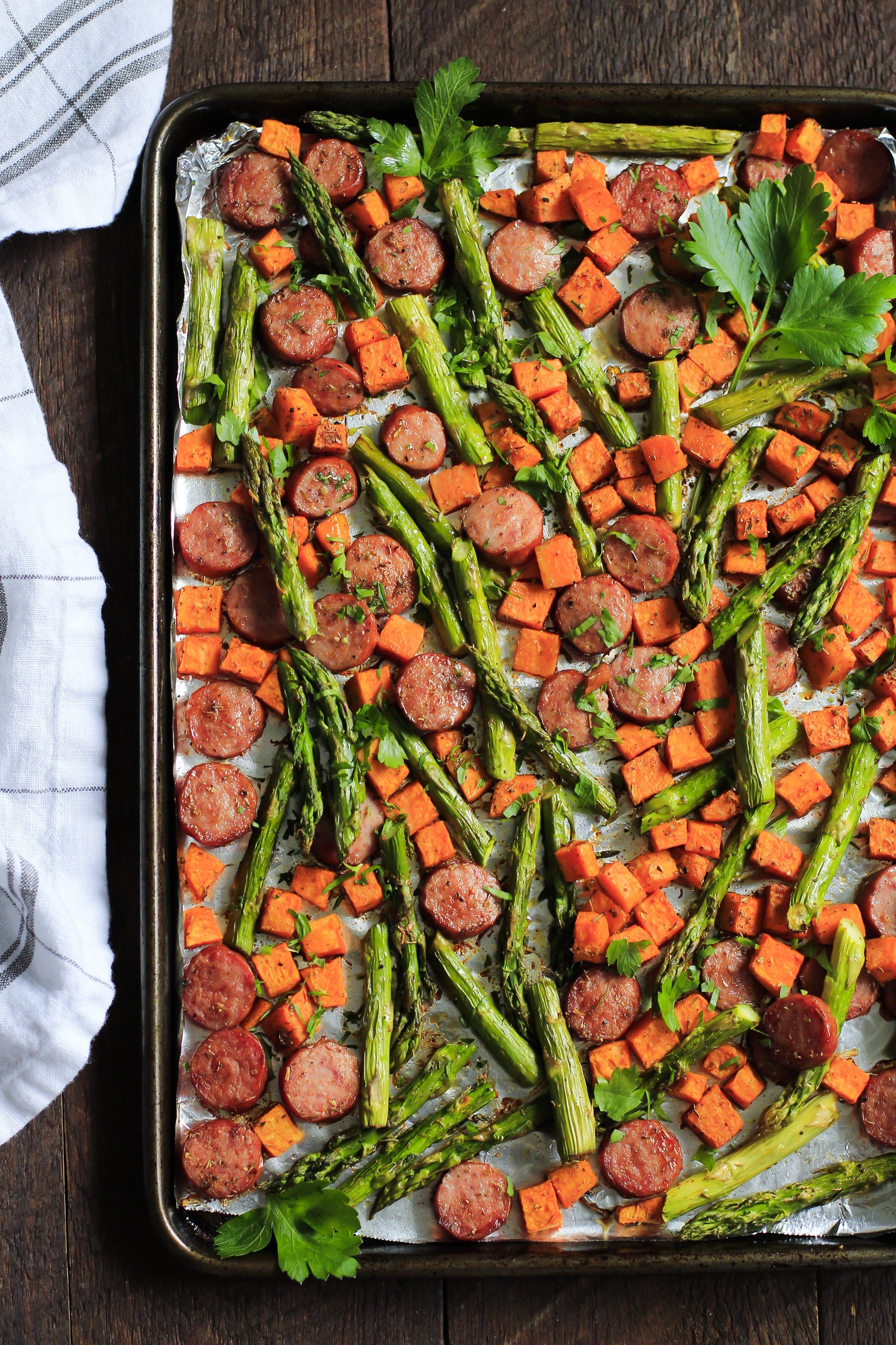 One-Pan Dinner Recipe - Sheet pan with sausage, asparagus, and sweet potatoes.