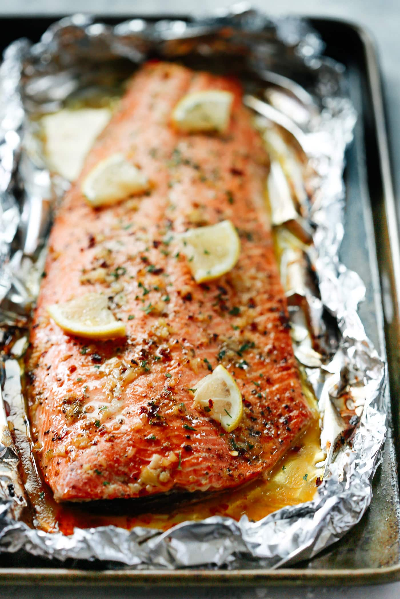 close up of salmon fillet in a baking sheet