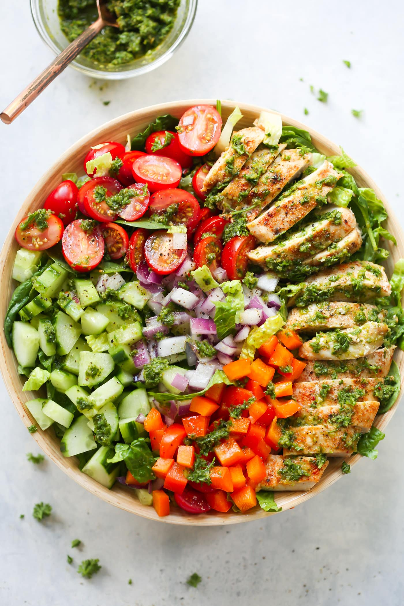 overhead view of a chimichurri chicken chopped Salad bowl