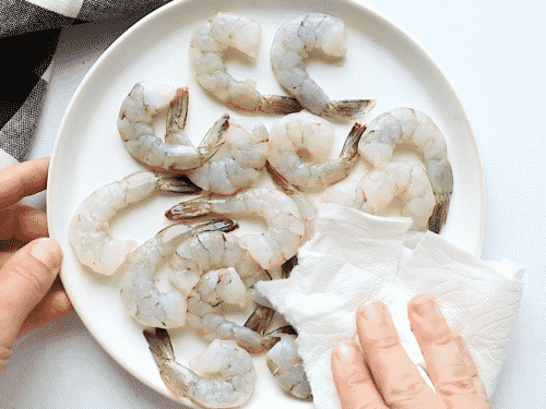 raw shrimp in a white plate