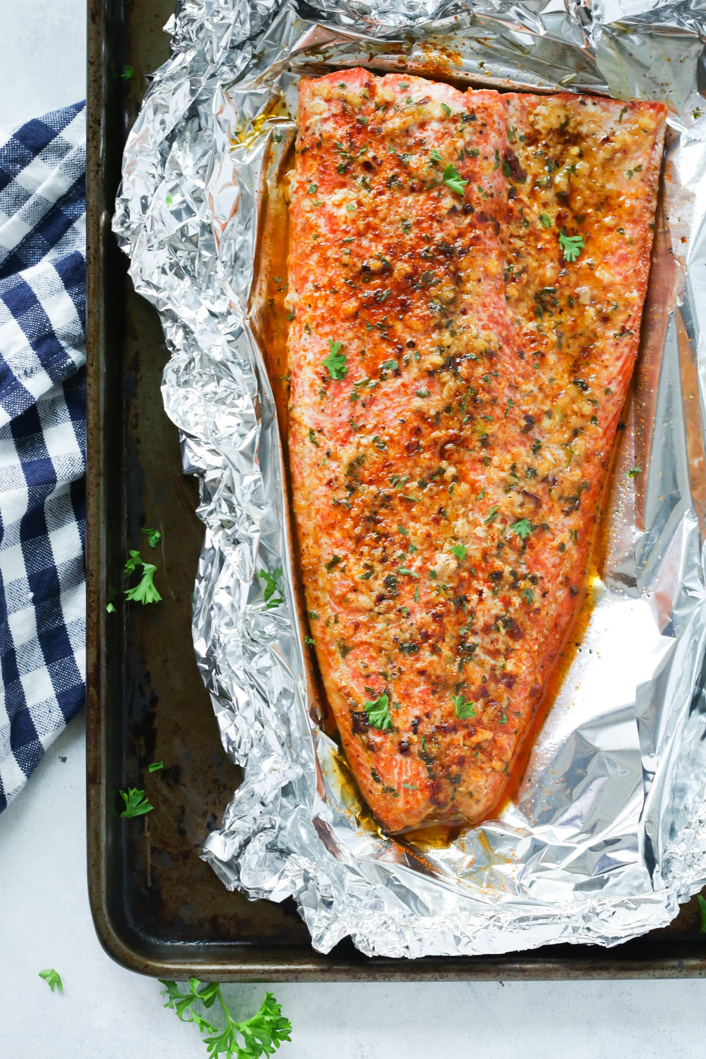 overhead view of salmon fillet in a baking sheet