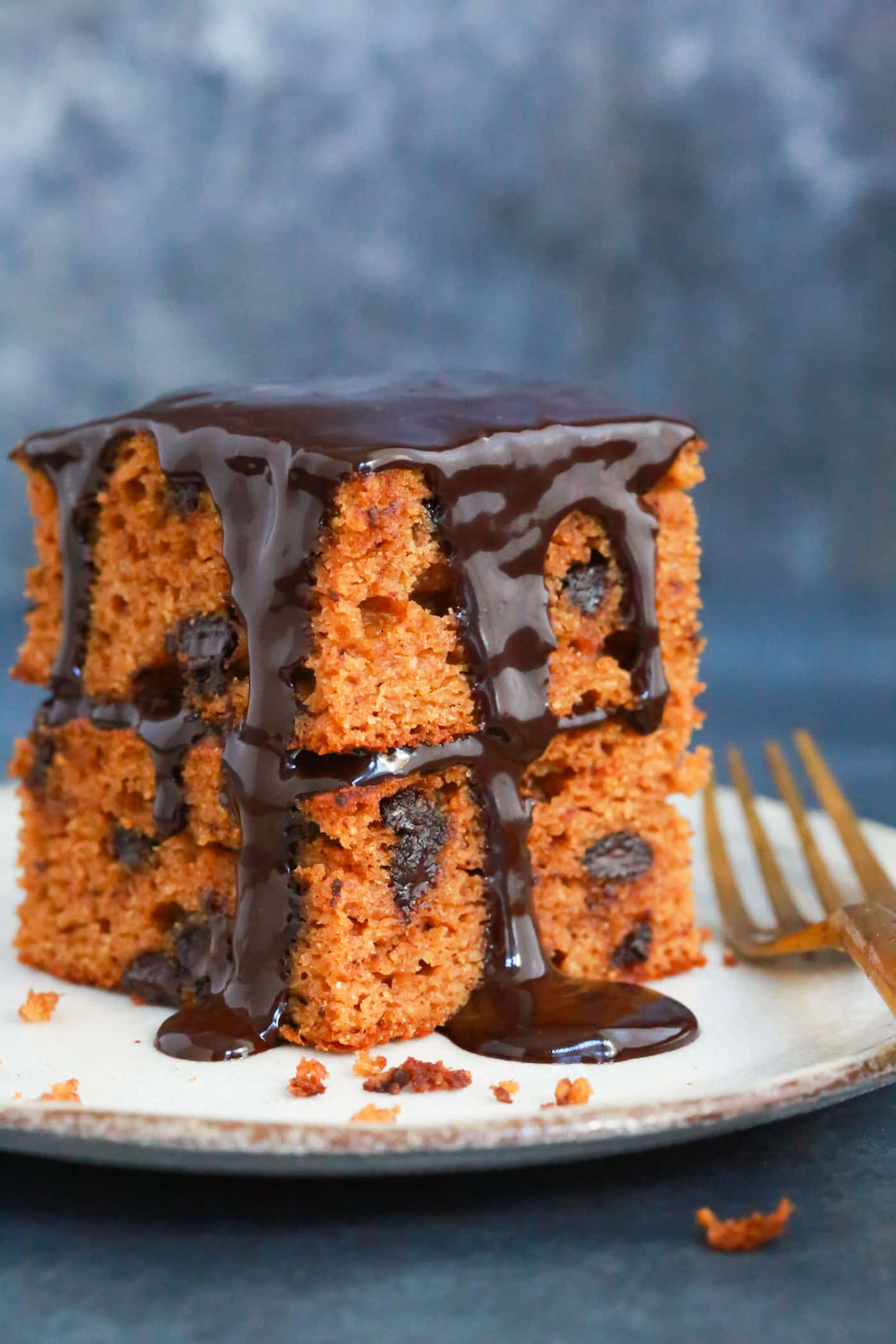 You'll never believe that this super moist and rich paleo chocolate pumpkin cake is actually healthy. It's gluten-free and made with peanut butter, almond flour, pumpkin puree and coconut milk.