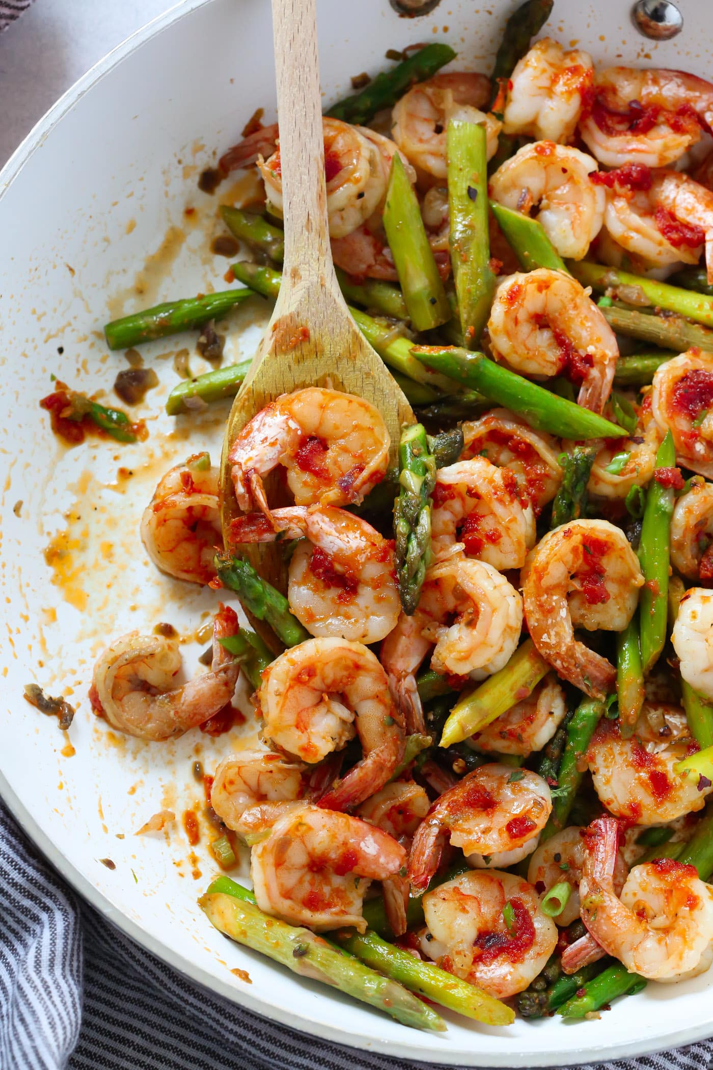 You'll love this Sun-dried Tomato Pesto Shrimp Asparagus Skillet recipe because it's made with super easy homemade sun dried tomato pesto and it's ready in just 20 minutes.