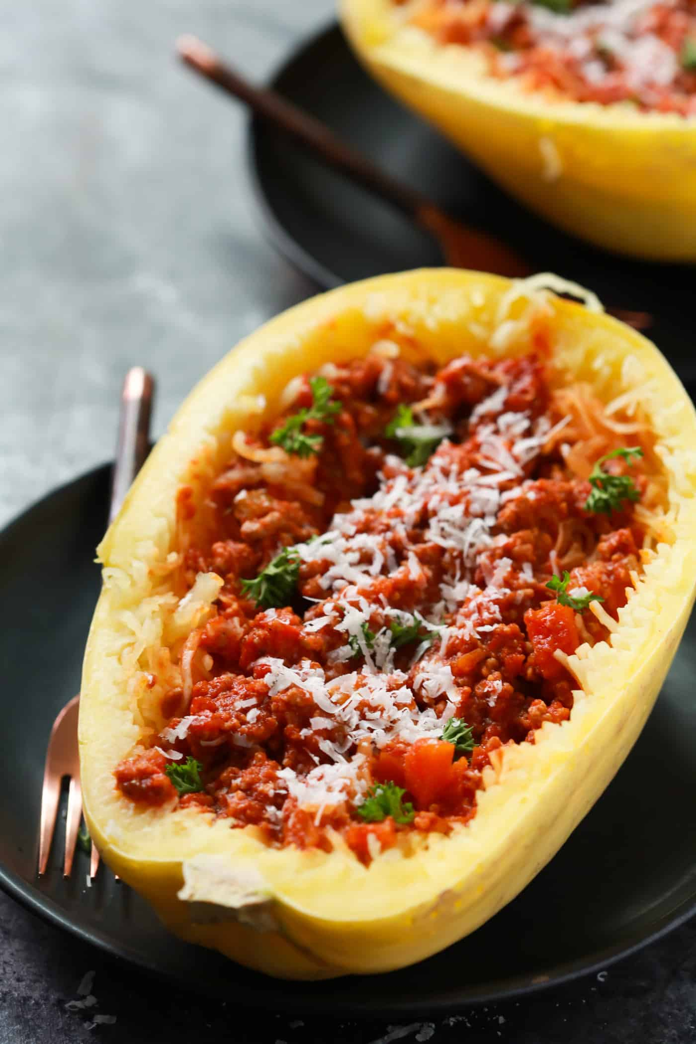 Comforting Food doesn't need to be full of carbs, right? I can prove what I'm saying with this super delicious Easy Bolognese Stuffed Spaghetti Squash recipe. It's also gluten-free and paleo friendly. Enjoy!