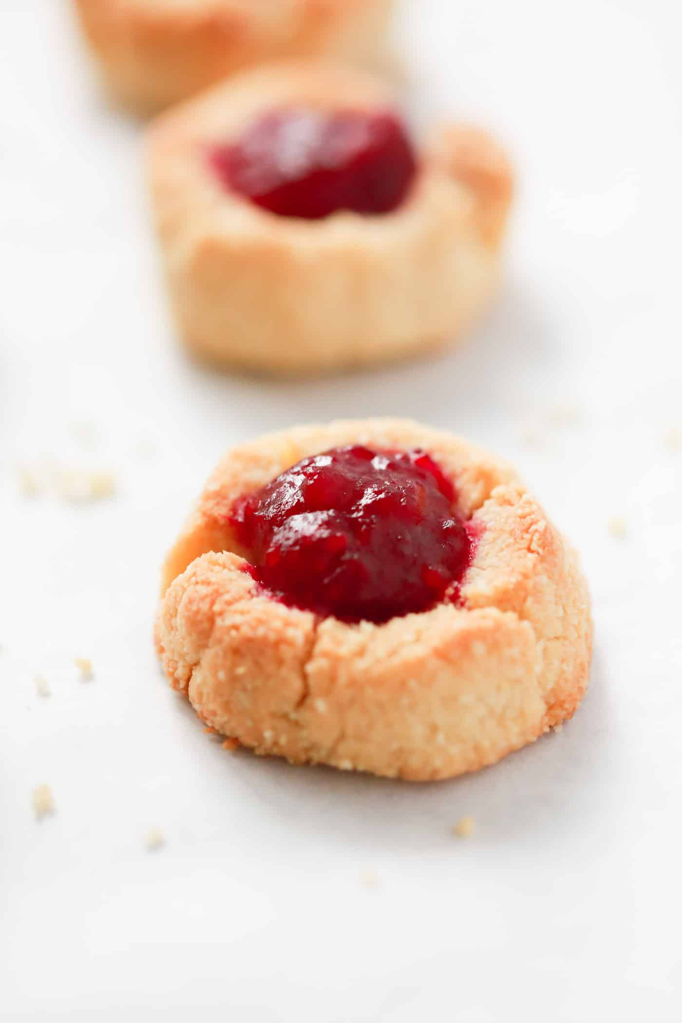 Delicious Low-carb Cranberry Thumbprint Cookies made with almond flour, butter, vanilla extract, natural sweetener and homemade cranberry sauce/jam. It's gluten-free, sugar-free and tastes amazing!