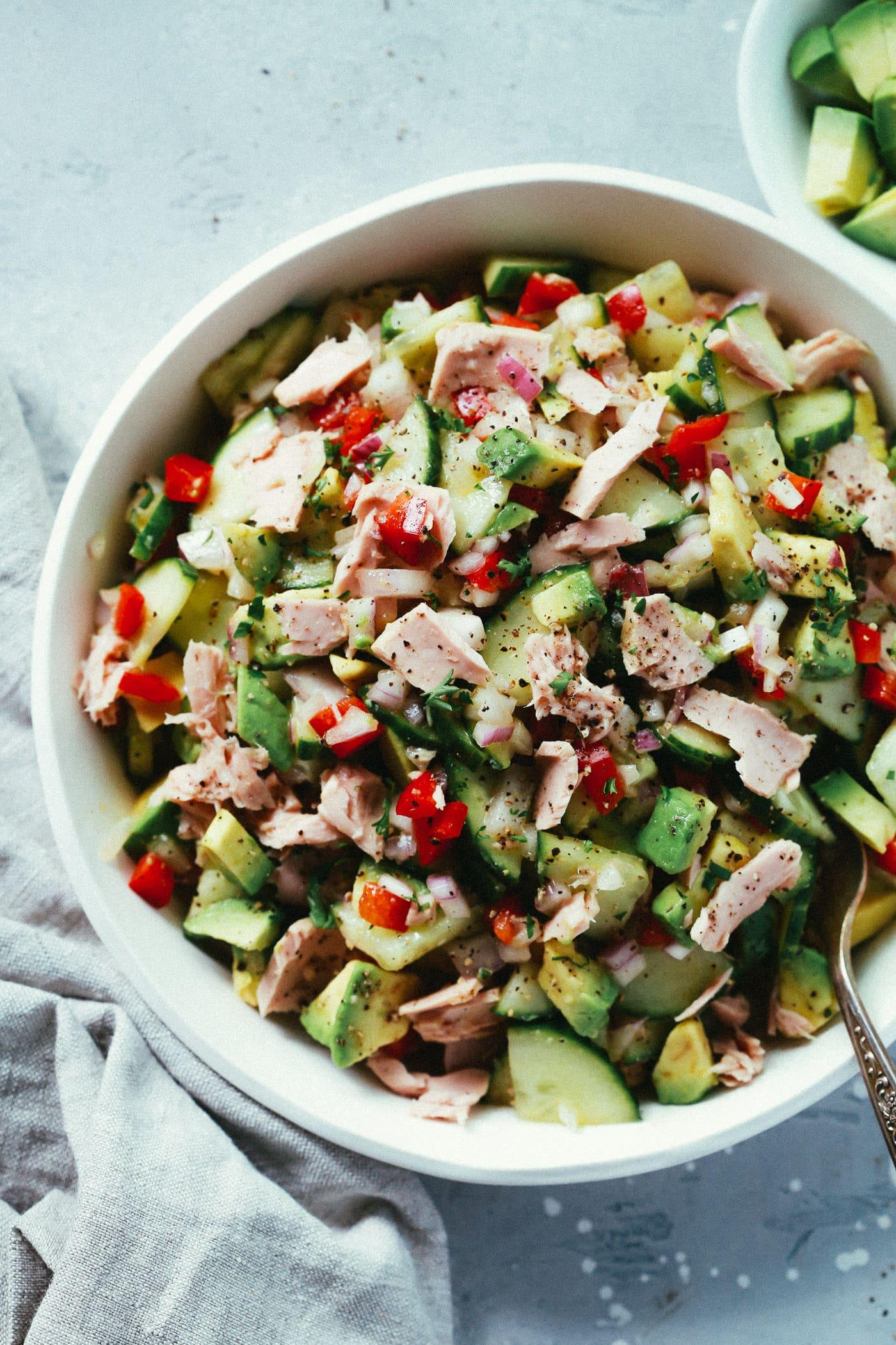 Overhead photo of a bowl of avocado tuna salad.