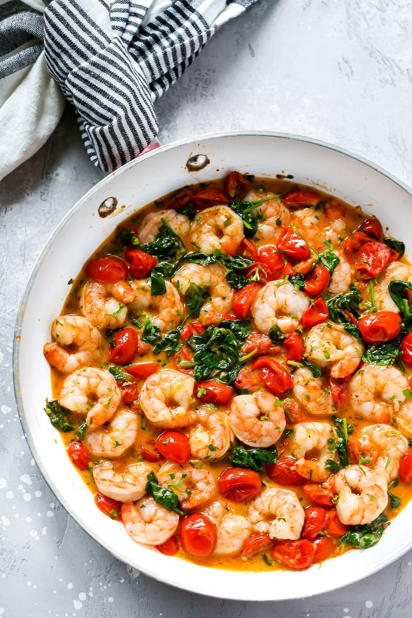 A white skillet with creamy parmesan shrimp. - Healthy Shrimp Dinner Recipes