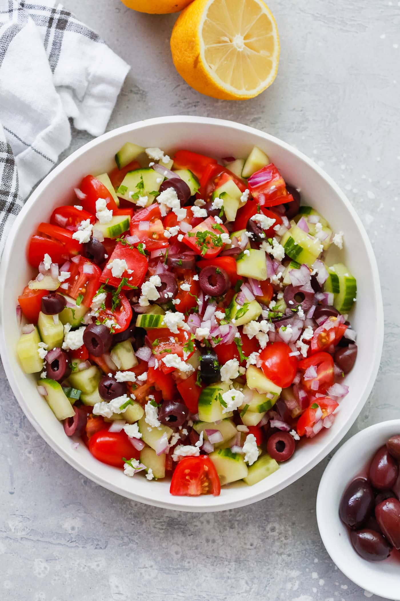 Overhead photo of a white bowl of mediterranean salad.