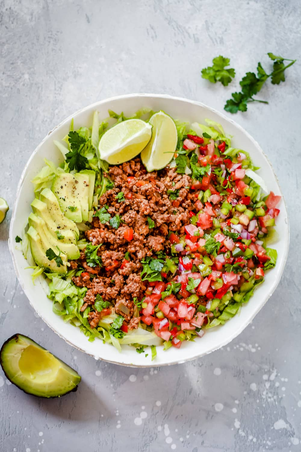 Ground Beef Taco Salad with avocado slices and salsa