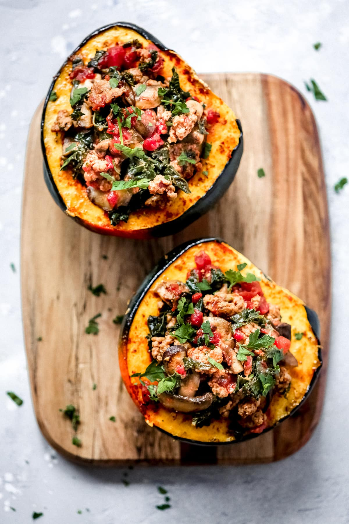 overhead view of sausage and kale stuffed acorn squash