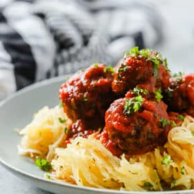 A close up of a plate containing Spaghetti Squash and Meatballs