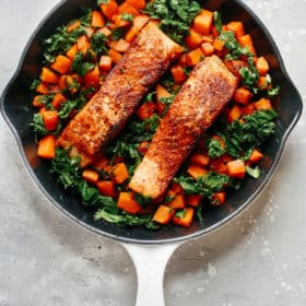 overhead view of a white skillet containing Salmon Sweet Potato inside.