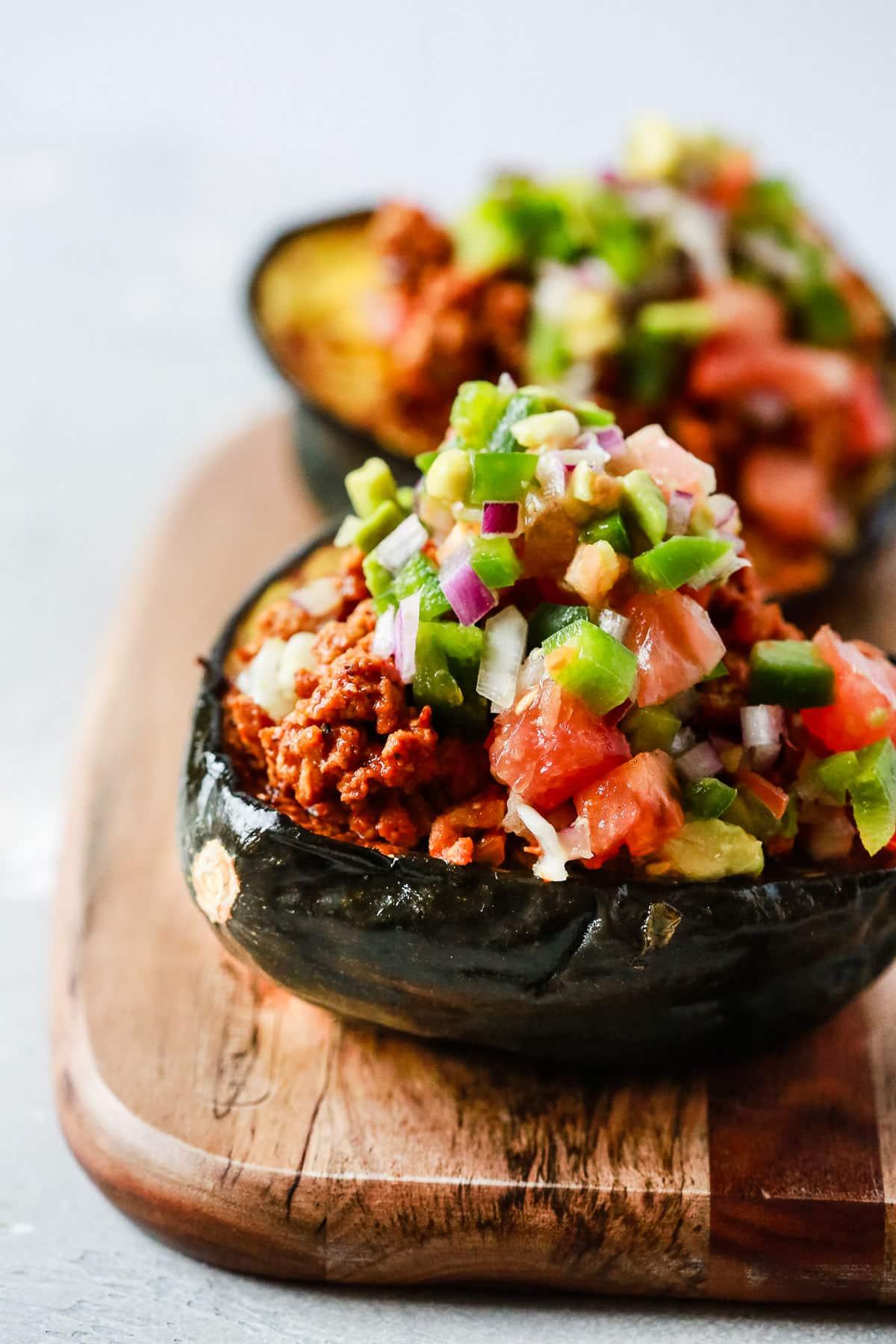A close up of taco stuffed acorn squash