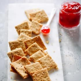 overhead view of Low-Carb Almond Flour Crackers on a marble serving board