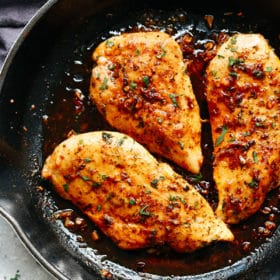 A skillet filled with garlic butter chicken breast