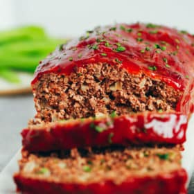 healthy turkey meatloaf with two slices cut from the loaf