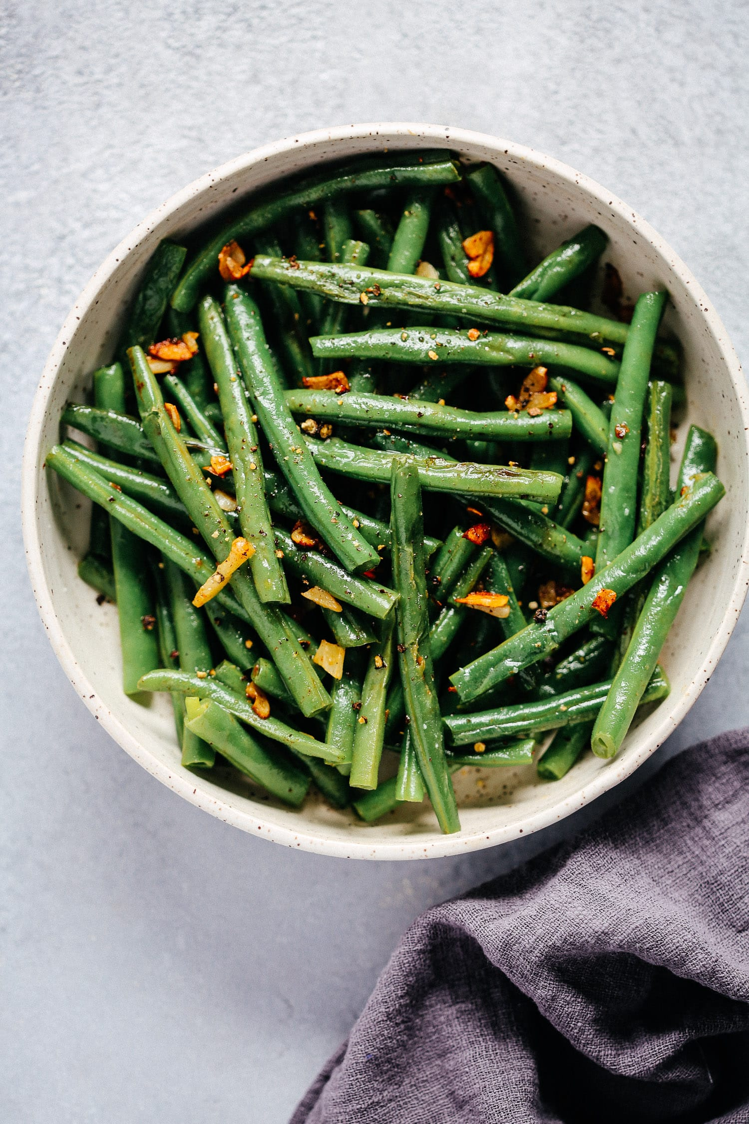 bowl of fresh grean beans with garlic and butter