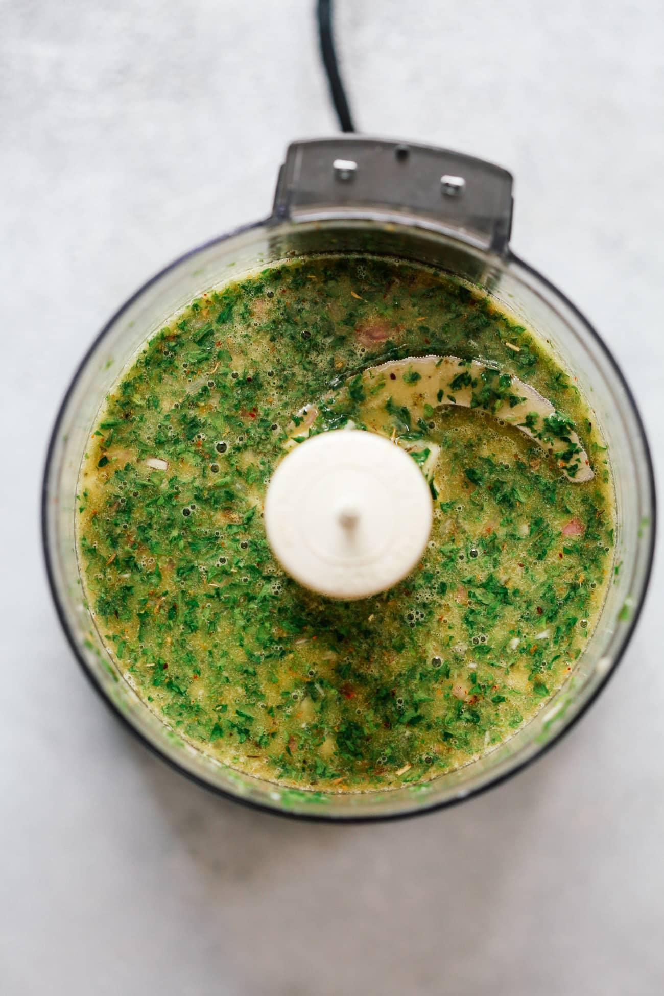 Making a chimichurri sauce recipe in a food processor