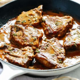 lamb chops with creamy mustard sauce in skillet