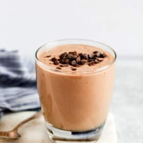 close up of a low carb chocolate smoothie garnished with chocolate chips