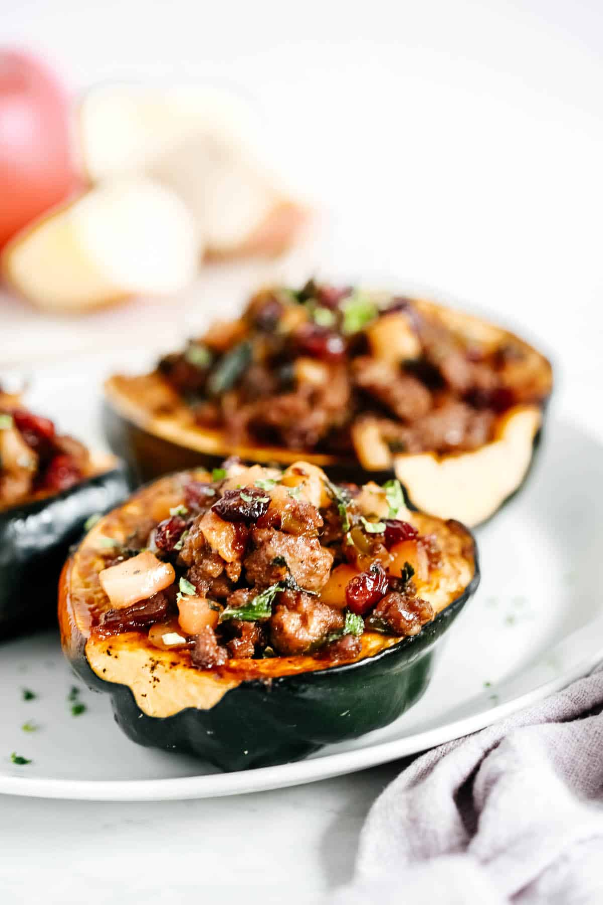 Two Stuffed Acorn Squash on a white plate