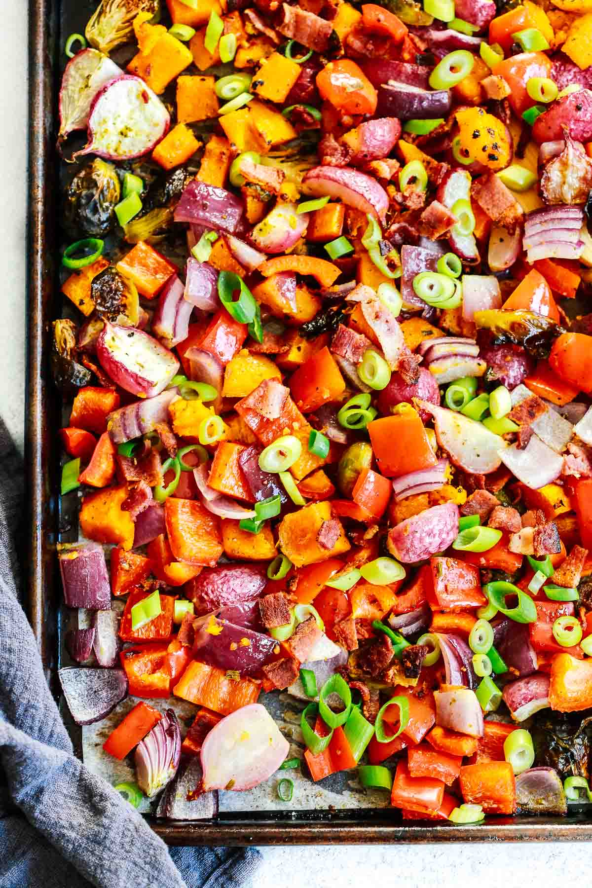 Overhead photo of a sheet pan with roasted vegetables.