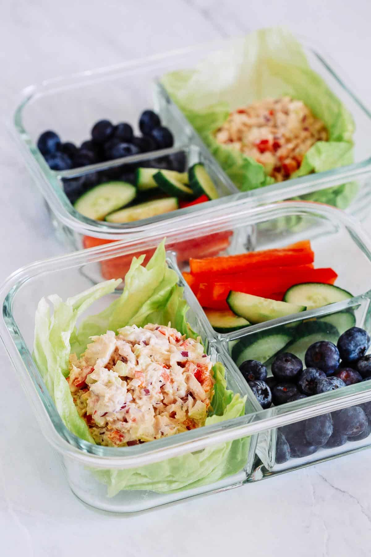 close up of Tuna Salad in a glass containers with veggies
