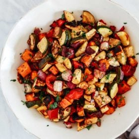An overhead photo of a white bowl with balsamic roasted veggies inside.