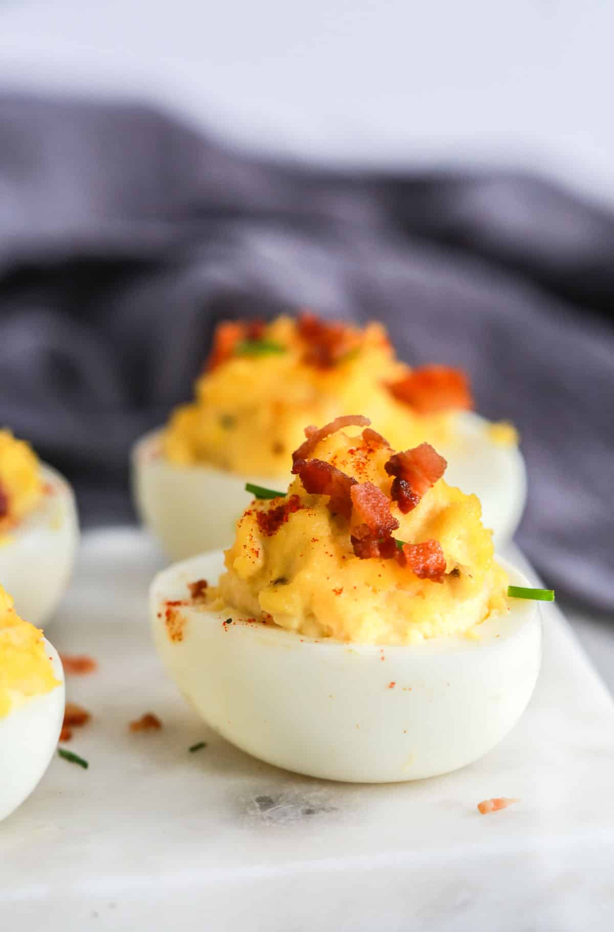 deviled egg appetizers on marble platter