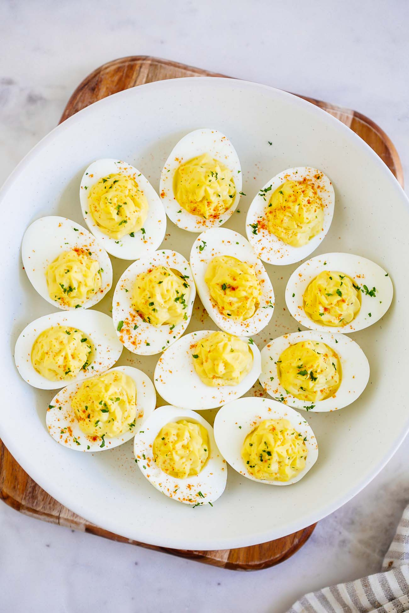 Overhead view of deviled eggs in a bowl.