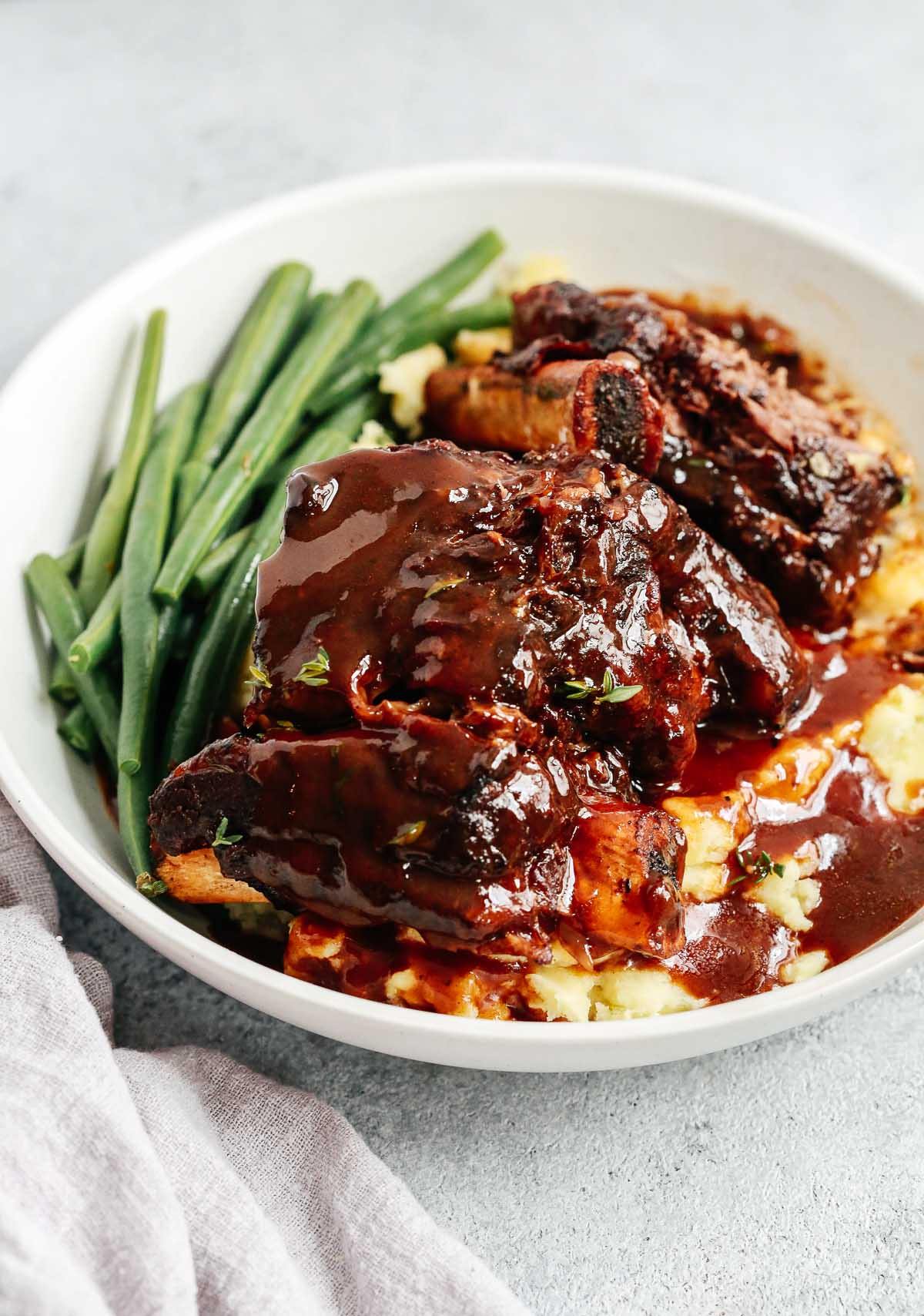 overhead view of a bowl containing Instant pot short ribs