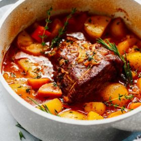close up of a large white pot containing Whole30 Pot Roast
