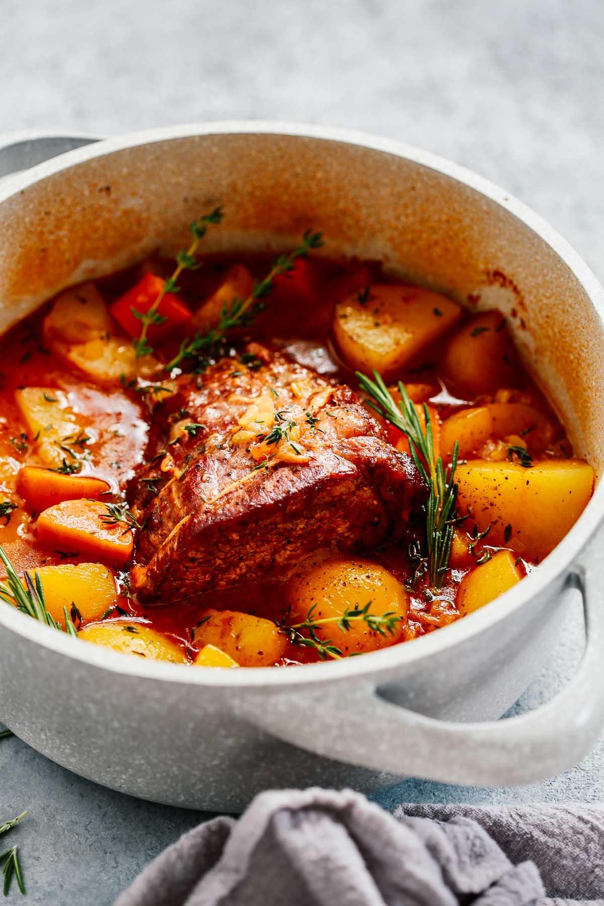 A grey pot containing a whole30 pot roast.