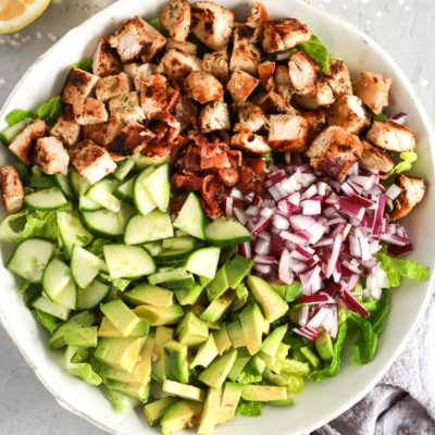 A white bowl of chopped chicken salad.