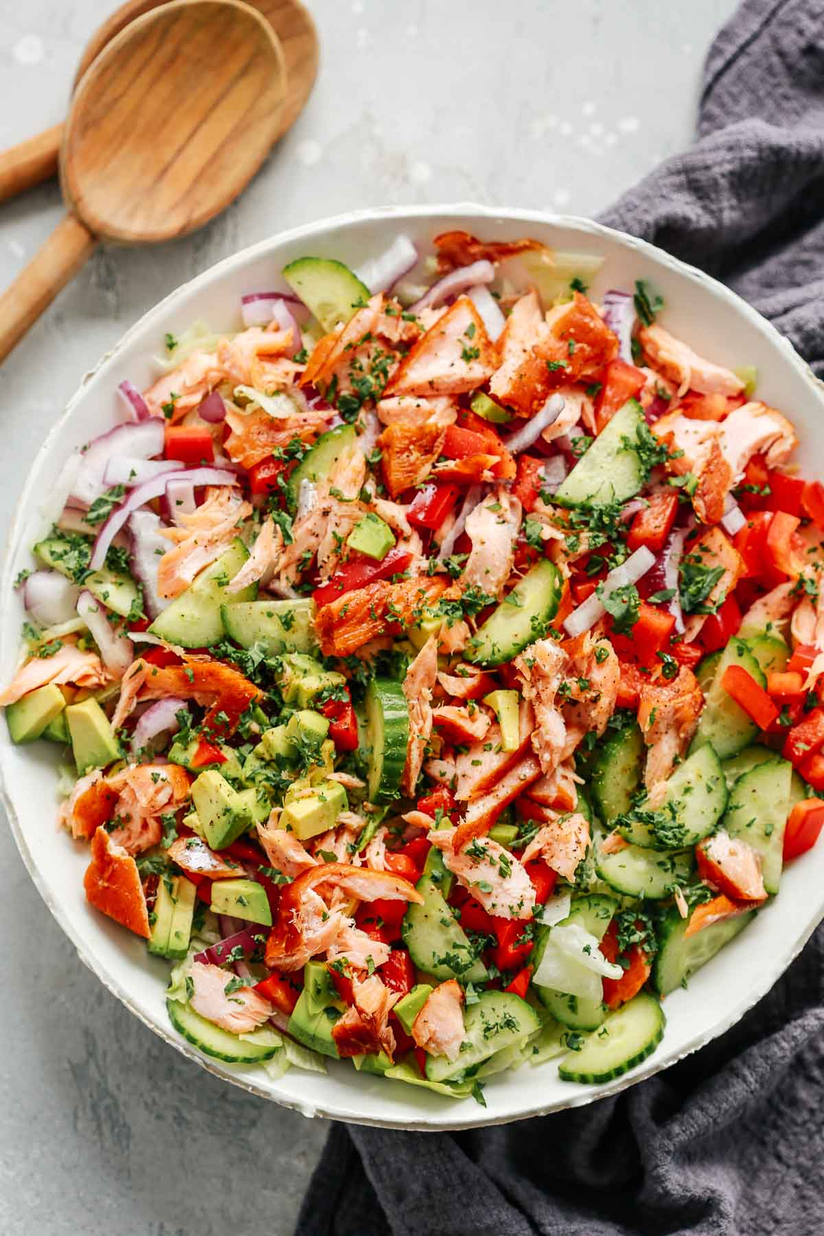 healthy chopped salmon salad in white bowl