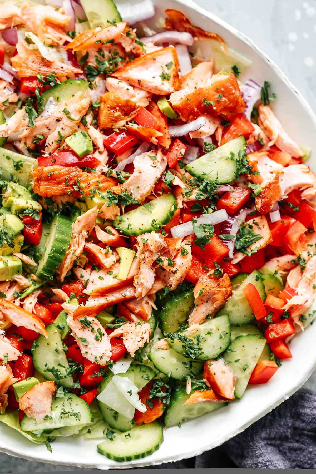 main dish salad with chopped vegetables and fish