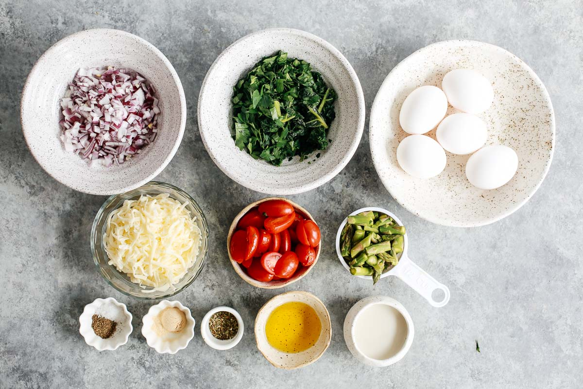 ingredients in bowls to make a baked eggs recipe