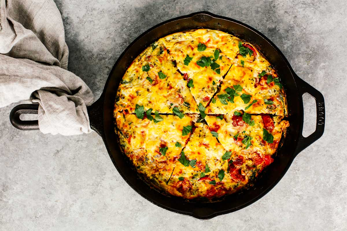 A finished vegetable frittata in a cast-iron skillet