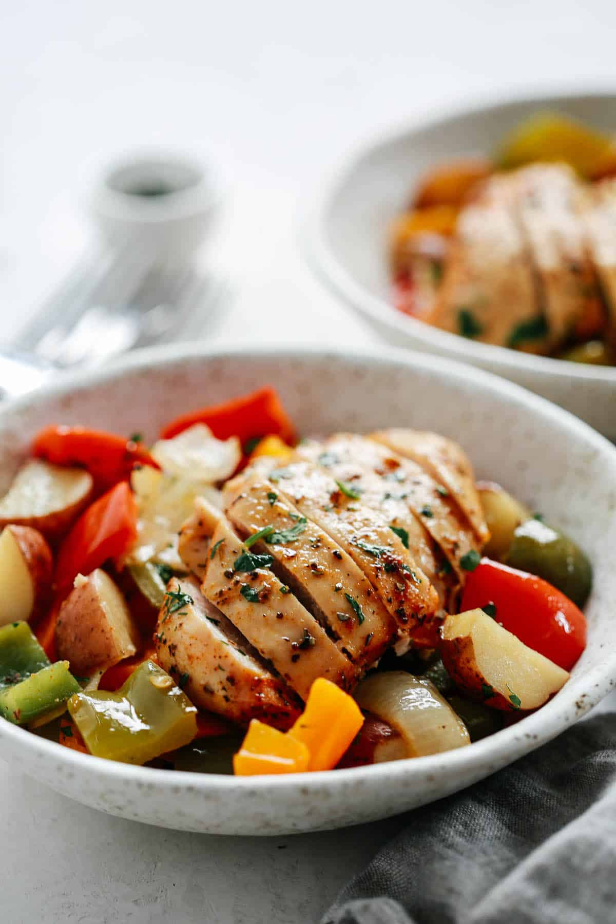 serving of baked chicken breast (sliced) with roasted vegetables