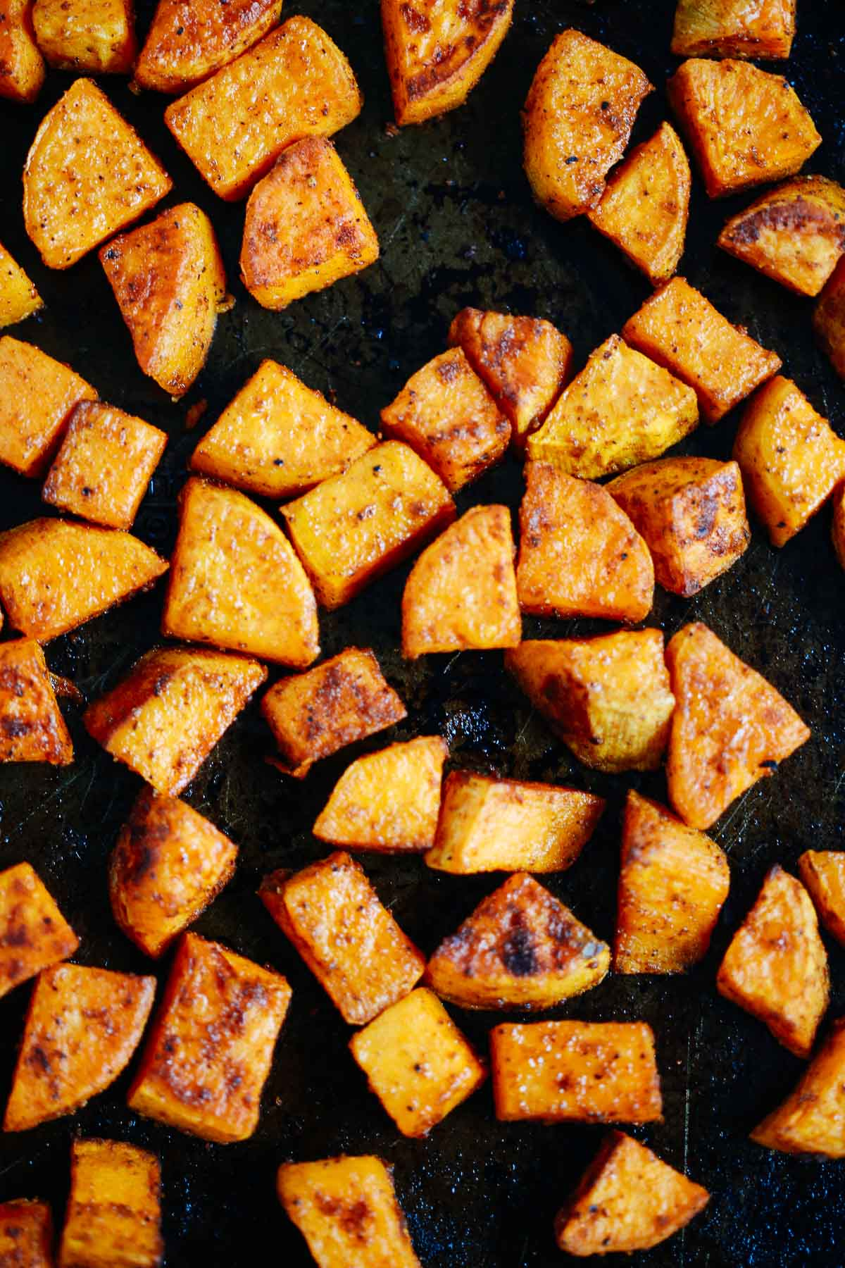 close up of roasted sweet potato on a baking tray