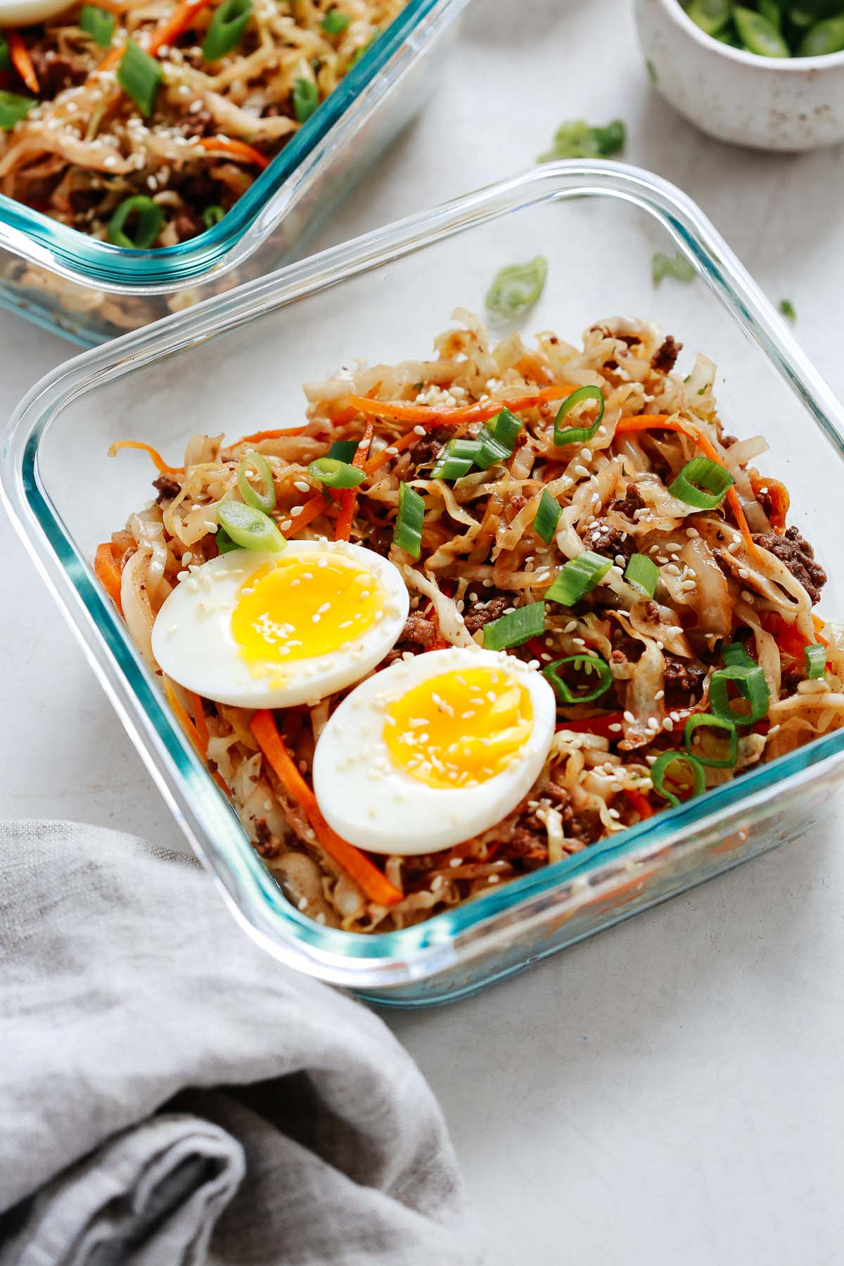 egg roll in a bowl with egg halves divided into containers