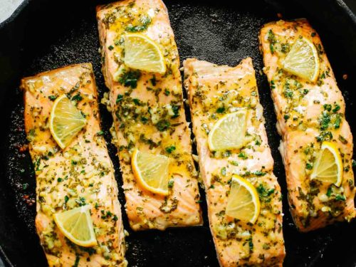 baked salmon with lemon in a cast iron skillet